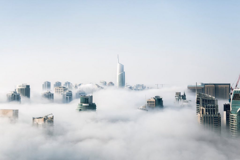 cityscape under cloud cover